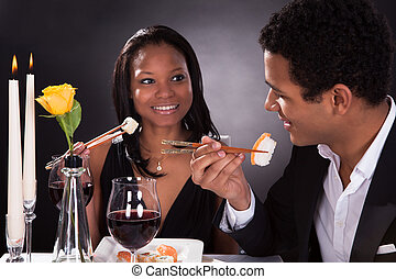 Romantic Couple Eating Sushi - Portrait Of Romantic Couple...