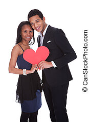 Young African Couple Holding Heart - Portrait Of African...