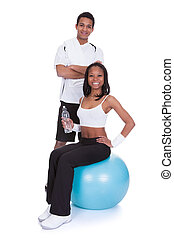 Young couple doing fitness