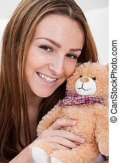 Young Woman Sleeping With Teddy Bear - Young Beautiful Woman...