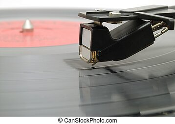 Needle on vinyl disk - The needle of an old player scratches...