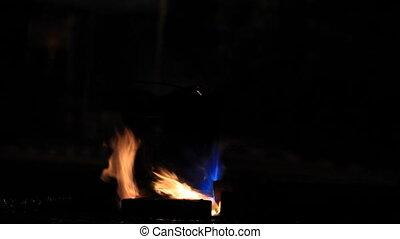 Fire heat metal pail in the dark