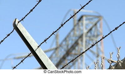 Barbwire Fence - Focus/Defocus of a Barbwire Fence with...
