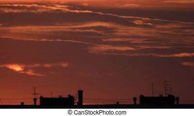 Town roofs on dawn clouds sky - Clouds sky sunrise in the...