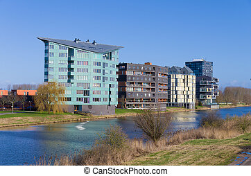 modern apartments along a canal in Almere, Netherlands
