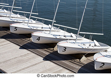 Rental Sailboats - Small rental centerboard sailboats line...