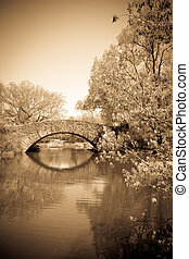 Central Park NY - View of lovely stone Gapstow Bridge in...