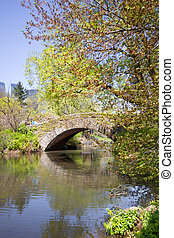 Central Park NYC - View of lovely stone Gapstow Bridge in...
