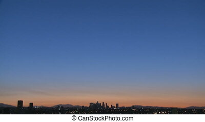 Los Angeles Skyline Sunrise - Tilt down to the sunrise of...