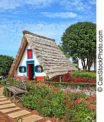 The white cottage with a thatched roof