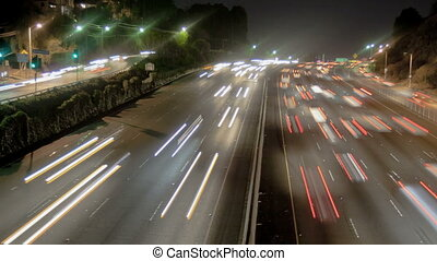 Highway Traffic at Night - Highway Traffic at night with...