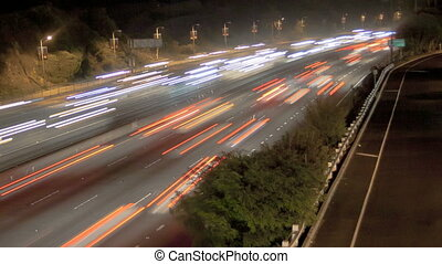 Highway Traffic at night with carlights passing by