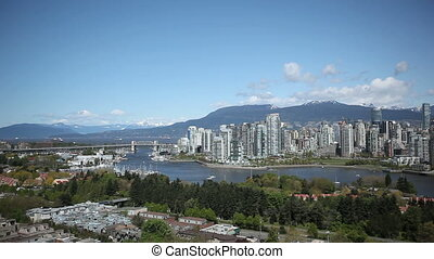 Vancouver Skyline during daytime with boats on the river