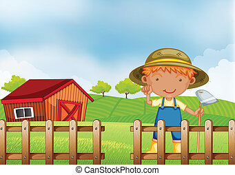 A farmer holding a hoe inside the wooden fence with barn -...