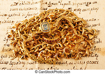 jewels - Mixed yellow gold jewelry on a letter
