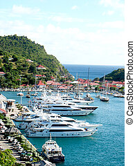 Aerial view at Gustavia Harbor with mega yachts at St...