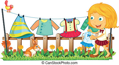 A girl hanging her clothes at the garden