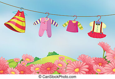 A garden with hanging clothes for the baby