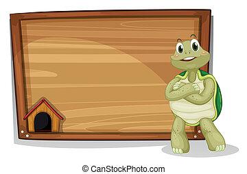 A turtle beside a wooden board