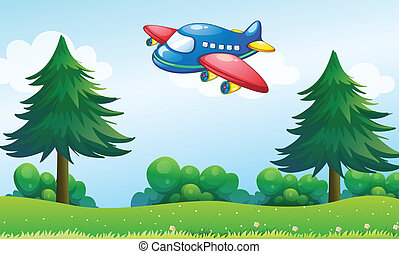 A toy plane flying above the hill