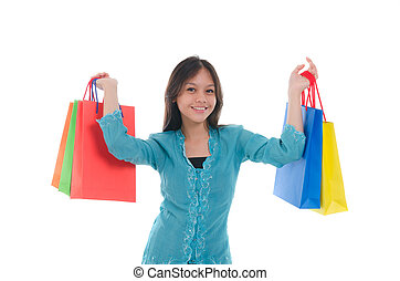 happy young malay girl during shopping festival with white background