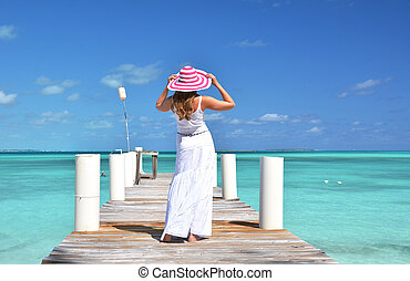 Girl on the wooden jetty Exuma, Bahamas