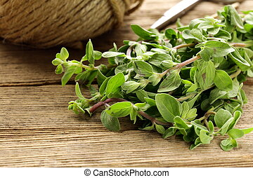 fresh organic oregano marjoram on a wooden board
