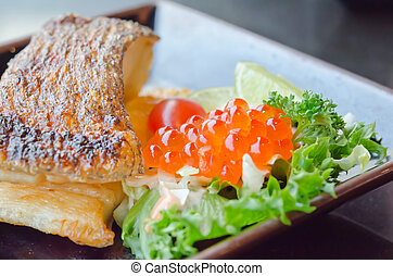 japanes cuisine - close up fish egg with salad and grilled...