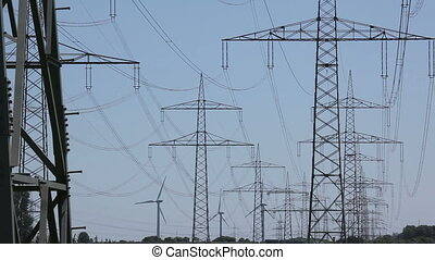Power Lines and Wind Turbines - Wind Turbines behind Power...