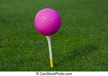 Pink golf ball on the grass