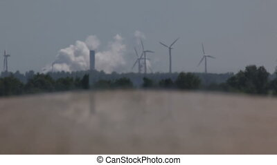 Power plant and wind turbines - Brown coal power plant with...