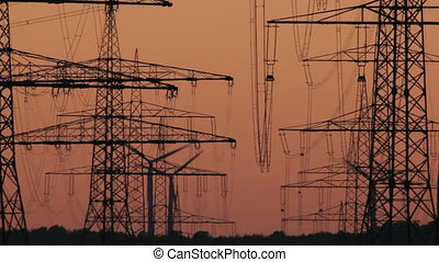 Sunset Wind Turbine and Power Lines - Wind Turbines behind...