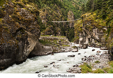 Pendant bridge on the way from Lukla to Namche Bazar in...