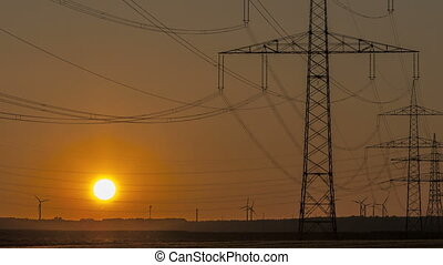 Timelapse Sunset Power Lines and Wind Turbine - Sunset...