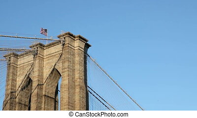 Flag on Brooklyn Bridge - US Flag on top of the Brooklyn...