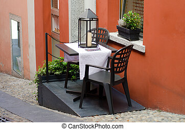 Table and chairs on a inclination street