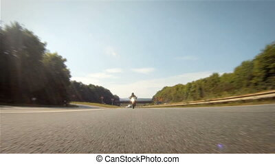 Motorcycle racing on the highway