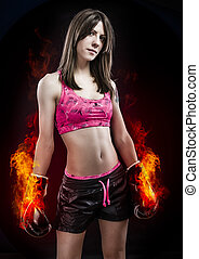 Boxing woman, pretty young boxing standing and defending by...