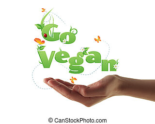 Go Vegan text - Hand holding Go Vegan text decorated with...