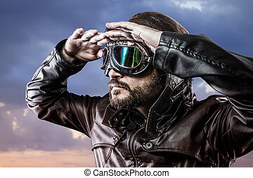 pilot with glasses and vintage hat with proud expression...