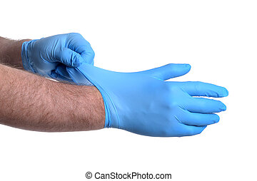 Latex Gloves - man putting on a pair of latex gloves