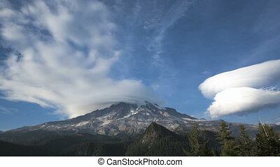 Mt Rainier - Timelapse of clouds passing the peak of Mt...