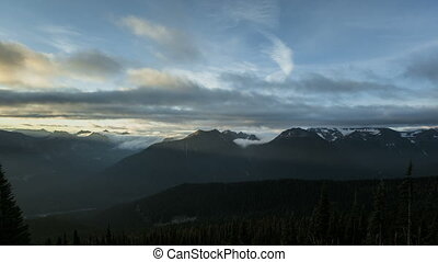 Mt Rainier - Timelapse of clouds passing the peaks at...