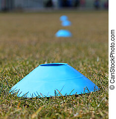 Sports training cones on soccer pitch
