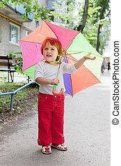 2 years child  with umbrella