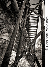 Steel stairs on a rail bridge - A shot of Steel stairs on a...