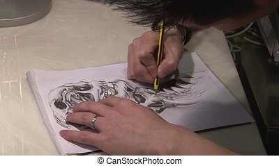 Artist drawing for tattoo