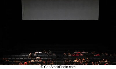 Viewers in the cinema house Variant with screen motion