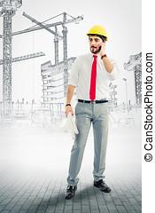 Architekt mit Plauml;nen und Handy auf der Baustelle -...