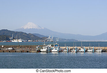 Motorboats at Shimizu port with mt Fuji in background